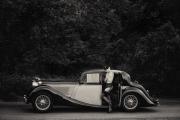 La-Chauffeuse-raphaella-vintage-jaguar-art-nude-trevor-yerbury